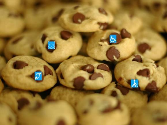 Galletitas respetuosas: Imagen de unas galletitas con chispas de chocolate, con los símbolos de los cuatro tipos de discapacidad en el interior de algunas de las chispas